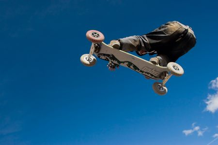 A mountainboarder in mid air with a deep blue sky in the background Stock Photo - 429226