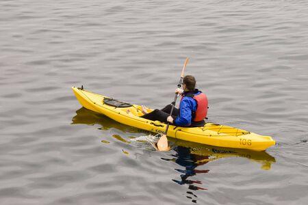 A man kayaks on the ocean Stock Photo - 435907