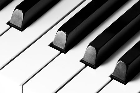 antique sleigh: black and white piano keys close up Stock Photo