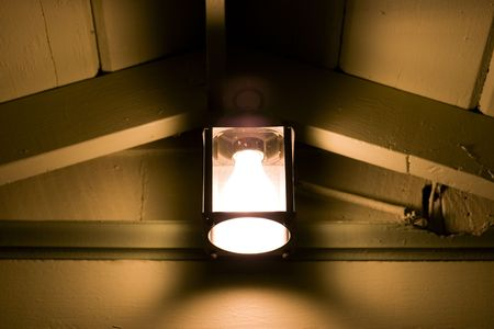 rafters: An antique porch lamp Stock Photo