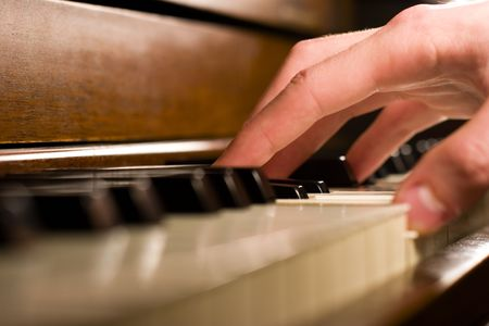 A caucasian males hand playing the piano Reklamní fotografie