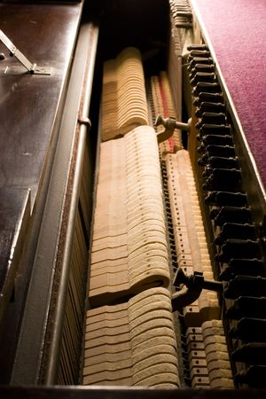 Details on the inside of an old antique piano