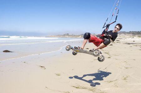 kiteboarding: Young man kiteboarding on the beach Stock Photo
