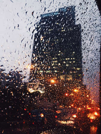 capetown: Skyscraper trough a window car with raindrops on it Stock Photo