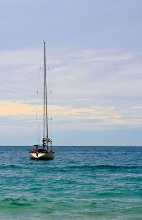 Lonely sailboat in sea, picture taken form Koh Samed, Thailand. photo
