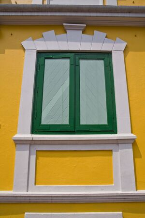 Green Windows and yellow wall photo