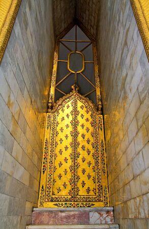 Golden doors with Thai patterns photo