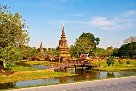 forground: Ancient pagoda in Ayutthaya, Thailand with lake in forground Stock Photo