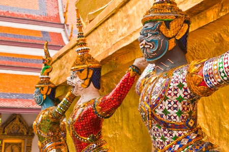 Titans and monleys   carry golden pagoda decoration in temple of emerald Buddha photo