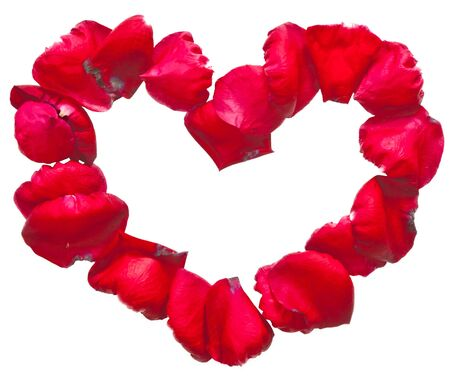 Red heart frame made by rose petals photo