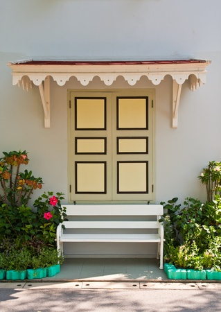Thai style facade with bench in front of windows Stock Photo - 9343029