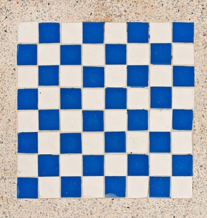 White and blue tile checkerboard on mable floor photo
