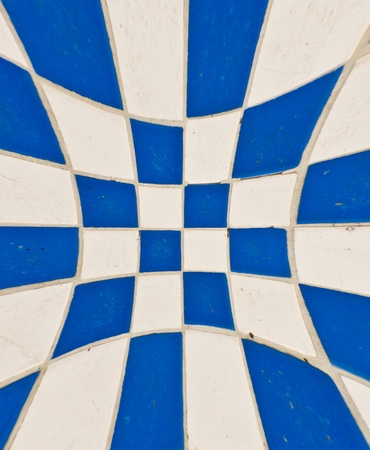 White and blue tile checkerboard on mable floor blast out photo