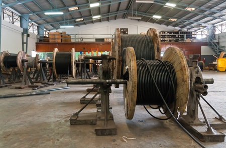 Wooden electric cable reels in stockpile for distribution Editoriali