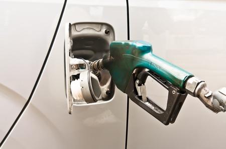 Handle of Dispensing fuel refueling petroleum into car photo