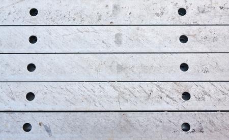 girder: Metal girder in group pattern in row surface Stock Photo