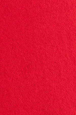 Smooth red carpet texture on floor surface background photo