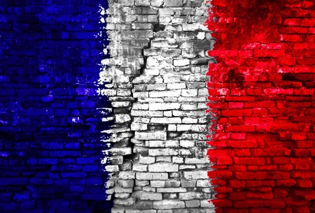 France flag painted on old brick wall photo