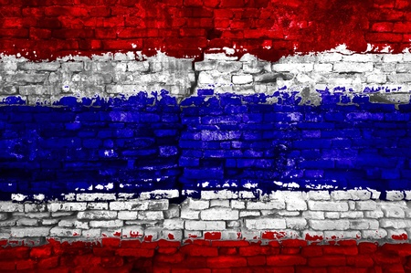 Thailand flag painted on old brick wall photo