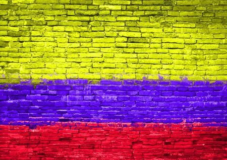 Colombia flag painted on old brick wall photo