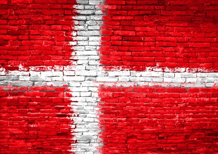 Denmark flag painted on old brick wall photo