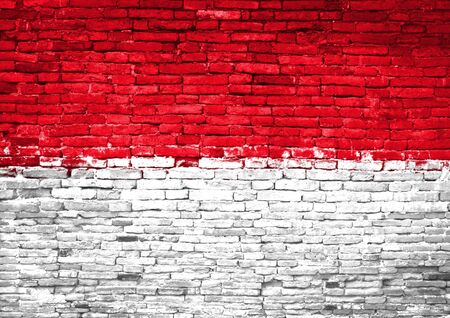 Indonesia flag painted on old brick wall Imagens