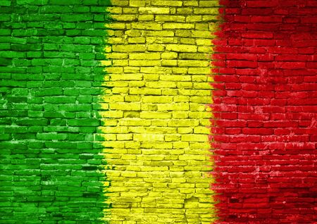 Mali flag painted on old brick wall photo