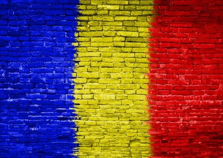 Romania flag painted on old brick wall