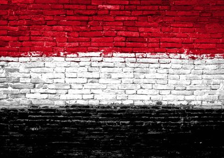 Yemen flag painted on old brick wall photo