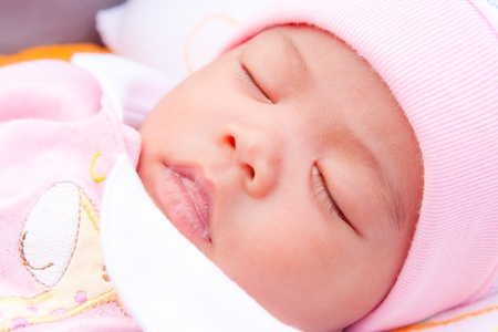 Face of Asian female newborn in pink dress  sleeping Stock Photo - 11802464