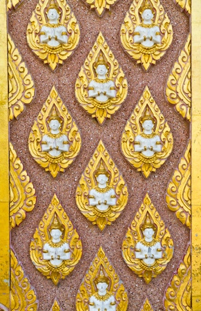 Angel decoration on wall in temple in Thailand photo