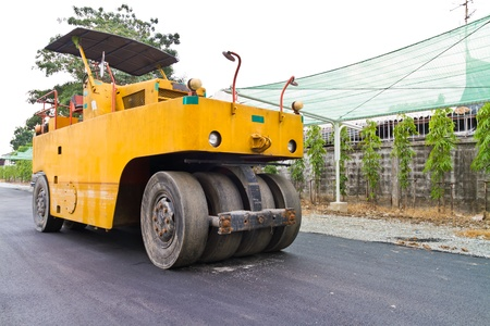 construction vibroroller: Steamroller on asphalt road under construction with nobody Stock Photo