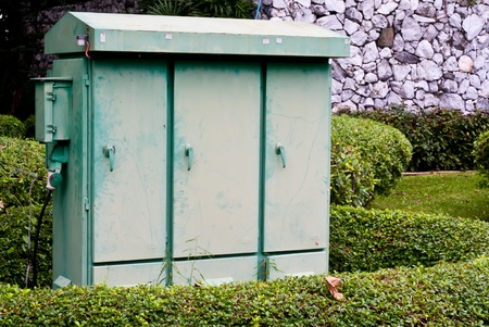 garden center: Metal electric substation cabinet in green park