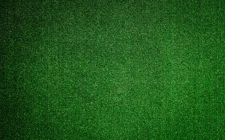 pasto sintetico: Fondo verde de la hierba falsa textura de la superficie