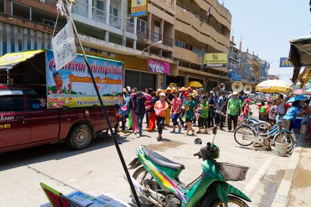 NAKHON SAWAN - APRIL 13 : Crowd of Thai people dancing and throwing water during the Songkran New Year Festival, April 13, 2012, Ladyao district, Nakhon Sawan, Thailand. Stock Photo - 13161732