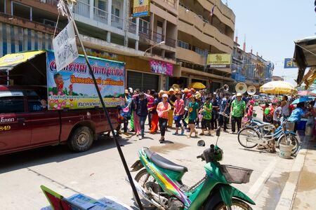 NAKHON SAWAN - APRIL 13 : Crowd of Thai people dancing and throwing water during the Songkran New Year Festival, April 13, 2012, Ladyao district, Nakhon Sawan, Thailand. Stock Photo - 13161732