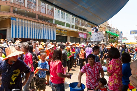 NAKHON SAWAN - APRIL 13 : Crowd of Thai people dancing and throwing water during the Songkran New Year Festival, April 13, 2012, Ladyao district, Nakhon Sawan, Thailand. Stock Photo - 13161734