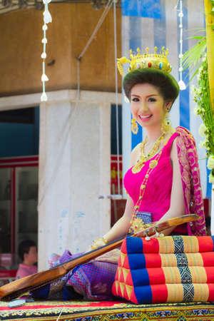 NAKHON SAWAN - APRIL 13 : Female Thai beauty contestant at a Thai Songkran festival Ladyao district market, April 13, 2012 in Nakhon Sawan, Thailand. Stock Photo - 13161716