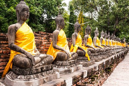 stone buddha: Stone Buddha statue in row in Thailand