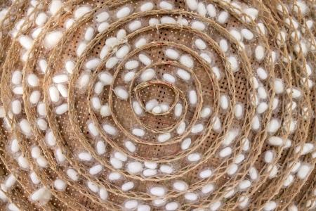 threshing: White silkworm cocoons in wooden threshing basket Stock Photo