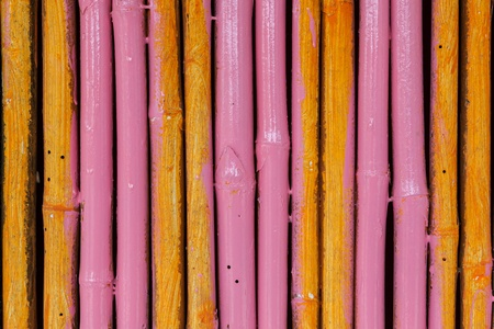 Seamless yellow pink bamboo stick striped pattern background texture surface photo