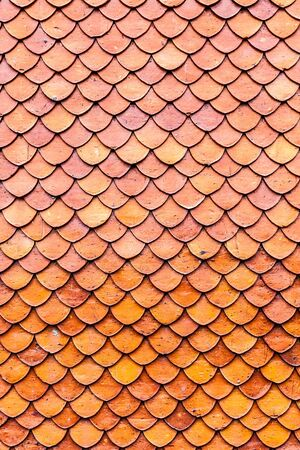 Orange brown clay roof surface seamless texture background photo