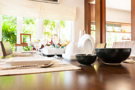 Group of kitchenware on wooden dining table photo