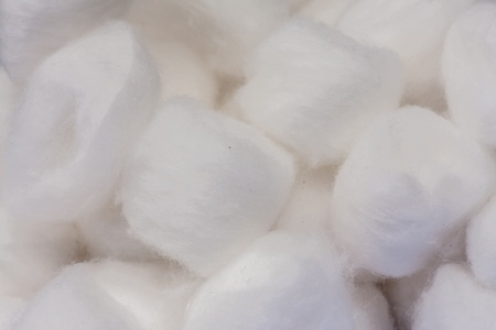 Pile of white cotton balls texture close up background photo