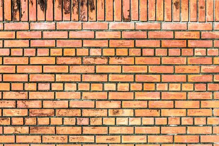 Orange brown brick wall seamless surface background texture photo
