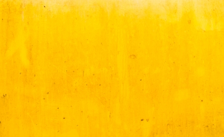 Dirty yellow metal plate surface texture background Imagens