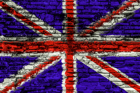 UK flag on old brick wall texture surface photo
