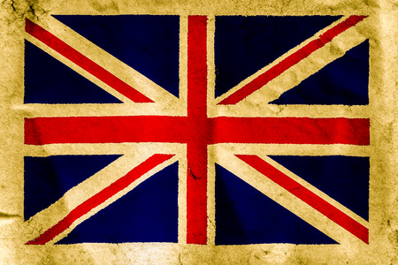 UK flag on old brown paper surface background texture photo
