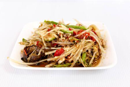 Thai traditional cuisine food papaya salad on white dish