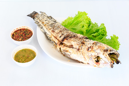 catfish: Grilled salted catfish on white dish Foto de archivo